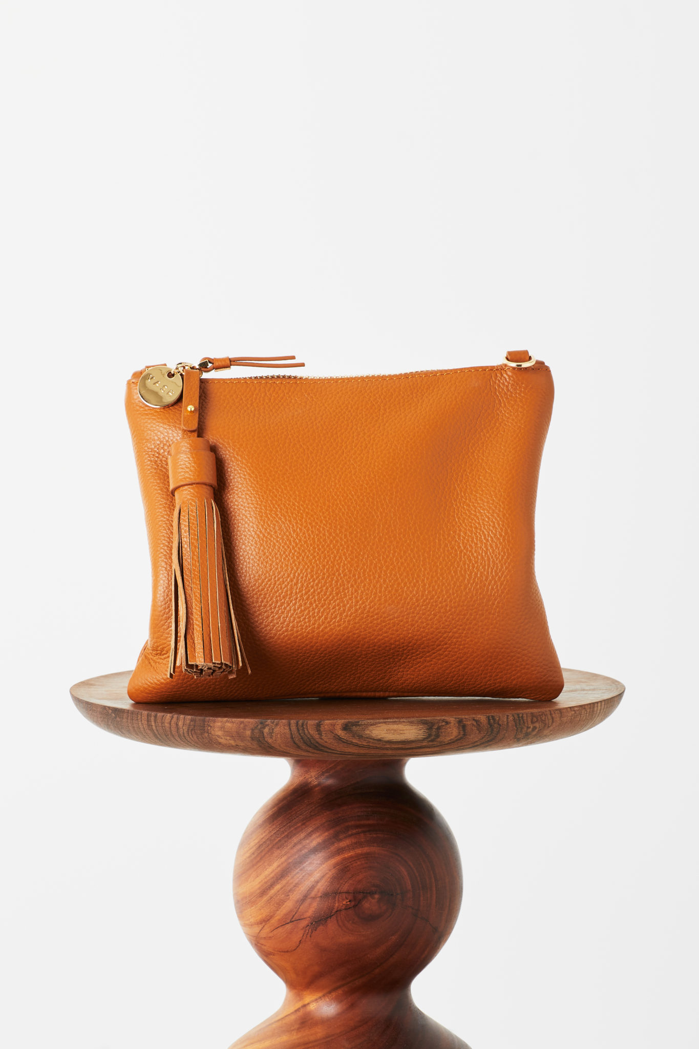 Mickey Flat Clutch In Orange Spice Leather